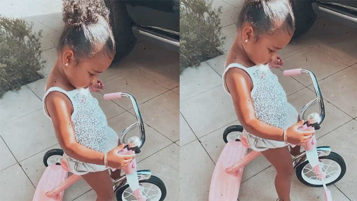 True Thompson Rides Her Pink Tricycle & Looks Cuter Than Ever Before