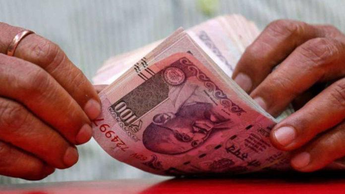 Rupee skids 19 paise amid renewed global trade tiff concerns