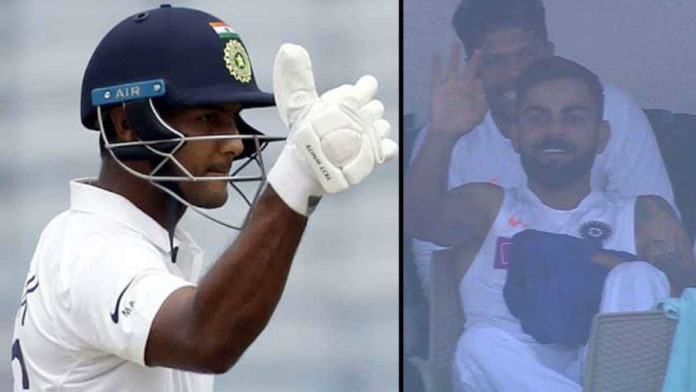 Mayank Agarwal responds with thumbs up after Virat Kohli signals him to go for 200